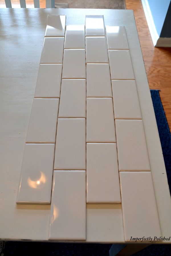 then we cut a tile in half to start our rows